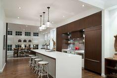 Modern Atlanta kitchen with row of Savoy House Pendants (SKU 7-5370-1-13)