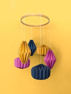 """A stunning hand crafted hanging mobile consisting of six individual geometric shapes folded from specialty stocks. A beautiful wooden """"halo"""" hovers above—complementing the materials below. A unique display worthy of any nursery or child's room. Nursery Room, Nursery Decor, Baby Nest, Hanging Mobile, Kidsroom, Geometric Shapes, Baby Shop, Baby Gifts, Babyshower"""