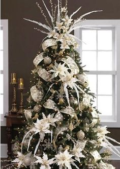 our wedding is December 7th- so I want a wedding Christmas tree! All white ornaments and babys breath throughout it....our wedding color is Navy blue...so maybe some Navy blue ornaments as well...