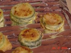 Parmasan Zucchini Snack  1 medium Zucchini (sliced in 1/2 to 1/4 in. rounds) 1 egg 1 t. EVOO 1/3 c. parmasan cheese  Line cookie pan ...
