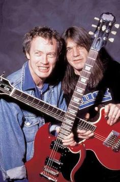 Brothers Angus and Malcolm Young of ACDC. Sadly, Malcolm passed away a couple of… Brothers Angus and Malcolm Young of ACDC. Sadly, Malcolm passed away a couple of years ago! Angus Young, Hard Rock, Elvis Presley, Epiphone Sg, Malcolm Young, Ac Dc Rock, Rock Y Metal, Bon Scott, We Will Rock You