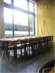 In the Clyde Common interior, the designers added visual interest to the space by using tarps as wall coverings and as curtains for the entryway