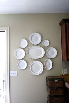 DIY - Goodwill Plate Finds Spray Painted and Hung - A Tutorial. It would look awesome if you took a picture and Mod Podge'd it in the center of the plates.: