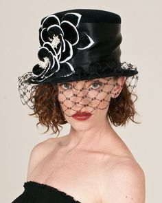 I wonder if this would look good on me. I need to go to LA and try it. Louise Green hat – Louise Green Millinery