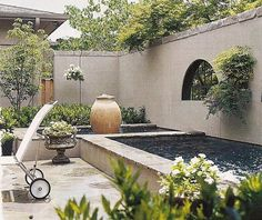 Walled patio with fountains
