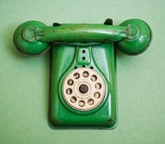 Green old fashioned telephone