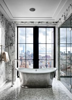 thedecorista:  a killer view is essential for a good bath….