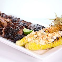 Honey-Chipotle Ribs and Crazy Street Corn Recipe: Turn this corn-on-the-cob recipe into a warm corn salad by carefully slicing the kernels into a bowl and mixing in the garnishes. The Chew Recipes, Corn Recipes, Beef Recipes, Mexican Food Recipes, Great Recipes, Dinner Recipes, Cooking Recipes, Favorite Recipes, Beef Meals