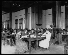 [Tuskegee Institute library reading room with male and female students sitting at tables, reading]. Photo by Frances Benjamin Johnston, ca. 1902. Frances Benjamin Johnston Collection, Library of Congress Prints and Photographs Division.