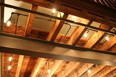 Exposed wood joists and pipe lighting Basement Ceiling Insulation, Basement Ceiling Painted, Exposed Ceilings, Wood Ceilings, Basement Ceilings, Basement House, Loft House, Basement Plans, Basement Remodeling