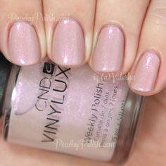 """""""Fragrant Freesia"""" has strong pink shimmer and white flakes in a pink-toned nude base. Lovely and delicate! Really nice formula. 2 coats. -- CND VINYLUX Fragrant Freesia 