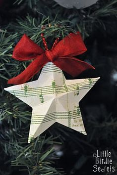 Stars pic 12. A single star is embellished with a red bow and a loop of thread is attached - and you have a Christmas tree decoration. I note that there isn't a central button or bead - not sure if that was intentional. #Christmas #craft #stars