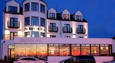 Bayview Hotel Bushmills Overlooking the Atlantic Ocean, this hotel is situated in the heart of the picturesque harbour-village of Portballintrae, one mile (1.6 km) from Bushmills.  Opened in 2001, the hotel is close to the Giant's Causeway and Old Bushmills Distillery.