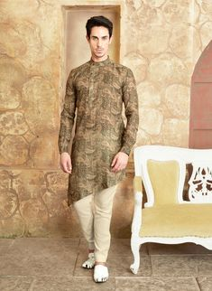 Rock any festive function by wearing this Dark khaki color Cotton Pathani enhanced with Stylish Buttons Work. Also comes with Beige Color cotton silk fabric Trouser. Mens Indian Wear, Mens Ethnic Wear, Indian Groom Wear, Indian Men Fashion, Mens Fashion Wear, Man Fashion, Kurta Pajama Men, Kurta Men, Wedding Dress Men