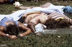 Dead bodies lie near the compound of the People's Temple cult November 18, 1978 in Jonestown, Guyana after over 900 members of the cult, led by Reverend Jim Jones, died from drinking cyanide-laced Kool Aid; they were victims of the largest mass suicide in modern history.