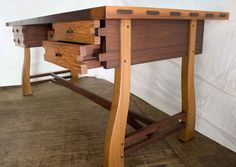 Elegant, harmonious wood desk. I particularly enjoy how the contrasting coloured joinery runs throughout even including the dowels. This could easily be made with reclaimed lumber. Reclaim. Reuse. Recycle. Renew. Upcycle. ╬