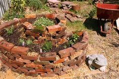 Build a spiral raised garden bed with bricks, via Glue and Glitter