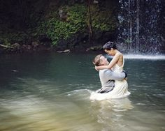 Love this idea of being in the water for engagement photos. Not in formal wear but swimwear