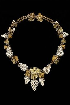 Necklace, England, ca.1850. Grapes and vine leaves were a recurrent theme, drawing inspiration from the gold jewellery of the ancient world. The fashion for sets of seed pearl jewellery continued through the Victorian era. This example has an intricate and complex construction. Gold wires provide the framework, and the seed pearls are attached with horsehair or silk.