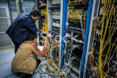 Two network administrators are working in the server room Royalty Free Stock Photo