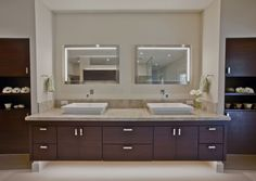 These sinks are so gorgeous.  Love how the mirrors match too.