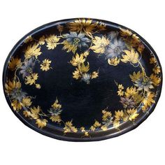 Victorian black lacquer papier mache oval shaped tray with gilt foliate and polychrome flower decoration.