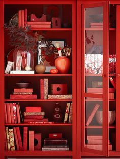 Bookcase Beauty - For the love of red! This is a monochromatic winner! More easy decorating ideas: http://www.bhg.com/decorating/seasonal/fall/easy-fall-decorating-projects/#