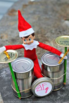 Funny Elf on the Shelf Ideas –  Elf Rock Band with Cans, Use Soup Cans for this…