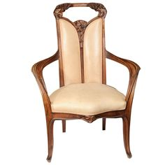 Pair of Louis Majorelle Arm Chairs  France  1900  A pair of walnut arm chairs by Louis Majorelle.