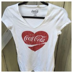 "CUTE COCA-COLA TEE! ⭐️HP⭐️ ♥️FUN COCA COLA TEE! In EUC. Nice and cool, this cap sleeved tee features a big ❤️ and gives up some love for an American Classic, the soft drink Coca-Cola. Vintage style, but not vintage. Freshly washed and Like NEW! Size large, but fits more like a medium. Slim fit.  percent cotton. ⭐️HP 6/20 ""Summer Staples"" by my PFF @shoefloozy ~ Shop her amazing closet!⭐️ TonisTwinkles Tops Tees - Short Sleeve"