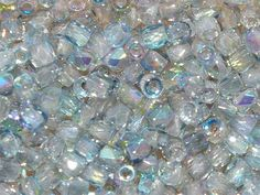 TRUE2™ 2mm Faceted Fire Polished Rounds Crystal Rainbow Blue from Nosek's Just Gems
