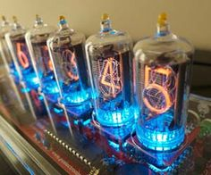 The nixie tube clock will bring a unique touch to any room with its eye-catching design. The custom made clock is composed of six independent nixie tubes that display the time and date through a dazzling display of neon lights. Casa Steampunk, Steampunk Design, Steampunk Lamp, Steampunk Pistol, Nixie Tube Watch, Steampunk Furniture, Paint Tubes, Geek Gadgets, Vacuum Tube