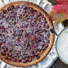 Brown Sugar-Cranberry Tart | The sweet-and-tart berries in the creamy custard pop when you take a bite.