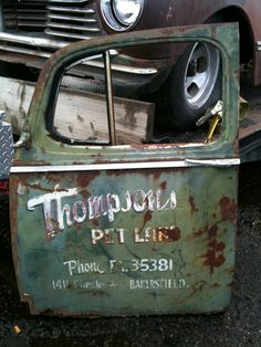 Love the rusty old paint on this door. What happened to the rest of the truck? Don't know that answer... Truck Lettering, Vintage Lettering, Old Garage, Garage Art, Farm Trucks, Old Trucks, Door Signage, Sign Writing, Old Logo