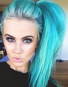 I like how you can see her natural colour at the roots then the bleached roots and then the colour.