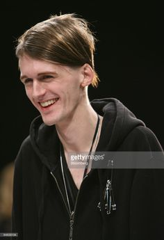 Fashion designer Gareth Pugh smiles before the showing of his 2007 autumn/winter collection during London Fashion Week in London, Thursday, Feb. 15, 2007.