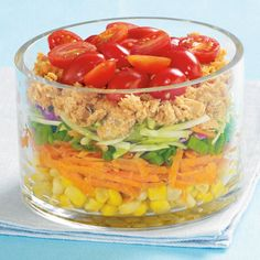 Cheer up your lunch time routine with this colourful and nutritious layered salad. Make on Sunday night and chill for three ready-to-go lunches. I would switch out the salmon with tuna (not a fan of salmon) Make Ahead Salads, Salads To Go, Main Dish Salads, Salad Bar, Soup And Salad, Lunch To Go, Lunch Time, Salad Recipes, Healthy Recipes