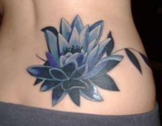 Elegant Lotus Flower Tattoo On Lower Back