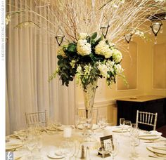 Winter Wedding Centerpieces With Branches | At each table, large birch branches burst from lush clusters of white ...
