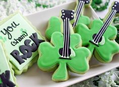 Make your St. Patrick's Day party stand out from all the rest by serving these clever and cute Rock and Roll Shamrock Cookies. Your guests will love that your St. Patrick's day dessert offerings aren't just Irish; they're rock and roll too! Holiday Treats, Holiday Recipes, Spring Recipes, Holiday Cookies, Holiday Fun, Bolacha Cookies, St Patrick Day Treats, St. Patricks Day, Candy