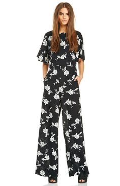 2920c601134 You ll fall in love with floral when donning our Blossom Jumpsuit by Line    Dot. This short sleeve playsuit features a sexy cutout back with tie  closure