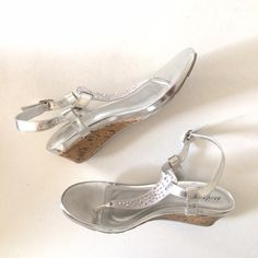 Silver sandals Metallic silver sandals. 1 inch cork wedge heel. Very comfortable. Worn once, but in great condition :) Shoes Sandals