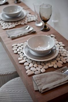 I love the irregular edges of these pebble placemats (pebbles from the dollar store, recycled heavy fabric and really good glue!)