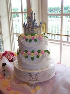 Porcelain Cinderella Castle with lovely white two tiered cake decorated with pink and yellow sugar roses.