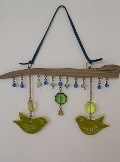 Mobile with drift wood, lime green ceramic lovebird and bead wall hanging