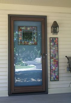 Cynthia Tinapple's front entry with polymer tile decoration