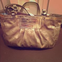 Used coach purse Its a beautiful bag it just needs to get a stain out on the inside (which i can do) and the handle strap broke  but can be fixed. Other than those two things its in really good shape. Its not really that old either Coach Bags