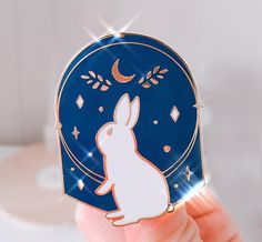 Starry rabbit gold enamel pin with backing. Dimensions: 1.5 inch / 40 mm Hard Enamel Pin Gold Plating, 2 Knobs Backing ** Shipping Policy ** I offer next day shipping for weekday orders. For orders placed on a Friday or the weekend, I ship the following Monday. Here are the