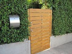 modern gate in hedge
