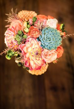 Bouquet of peach roses, dahlias, zinnias, and green succulents from Celsia Florist.